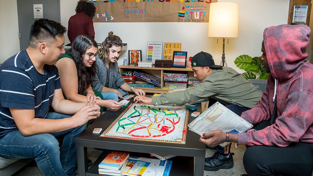 group of people playing a boardgame